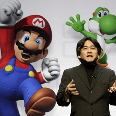 Mario with Yoshi and Satoru Iwata